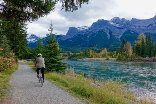 rear view of woman walking on mountain road
