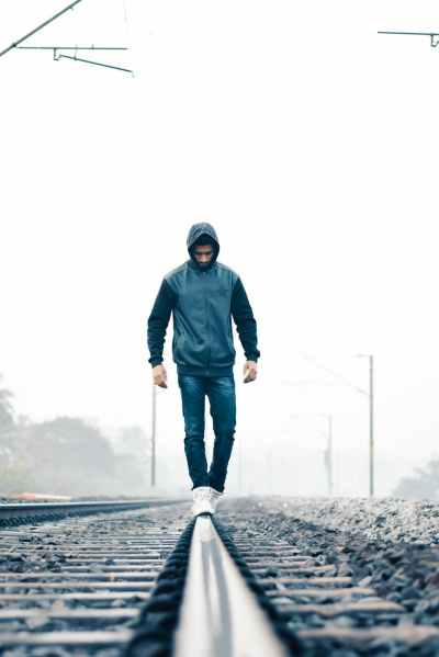 man walking on train rail